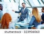 asian businessman presenting... | Shutterstock . vector #323906063