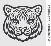 Stock vector tiger head logo mascot emblem 323908826