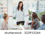 woman gesturing while... | Shutterstock . vector #323915264