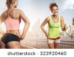 runner young beautiful woman... | Shutterstock . vector #323920460