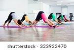 four girls practicing yoga ... | Shutterstock . vector #323922470