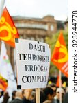 Small photo of STRASBOURG, FRANCE - OCT 4, 2015 Demonstrators protesting against Turkish President Recep Tayyip Erdogan's visit to Strasbourg - daesh terrorists and Erdogan is accomplice placard