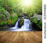 waterfall on a mountain creek....   Shutterstock . vector #323944880