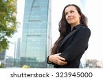 businesswoman portrait outdoors ...   Shutterstock . vector #323945000