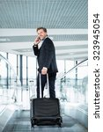 businessman with suitcase at... | Shutterstock . vector #323945054