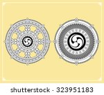 dharma wheel  dharmachakra... | Shutterstock .eps vector #323951183