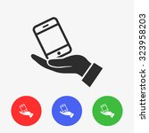 in the hands of the smartphone... | Shutterstock .eps vector #323958203