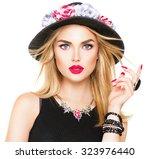 beautiful sexy blonde woman... | Shutterstock . vector #323976440