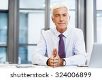 businessman standing in office... | Shutterstock . vector #324006899
