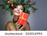 christmas happy woman over gray ... | Shutterstock . vector #324016994
