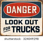 danger look out for trucks  ... | Shutterstock .eps vector #324049298