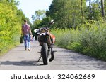 leaving the motorcycle on the... | Shutterstock . vector #324062669