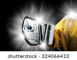 ice hockey goalie   glove save | Shutterstock . vector #324066410