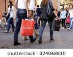 Small photo of ROME, ITALY - OCTOBER 03 2015: People walk with their Alcott shopping bag on Via Ripetta, main shopping street in the center of Rome, Italy