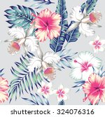 Stock vector tropic exotic hibiscus flowers orchid plumeria in trendy blue background with green leaves of a 324076316