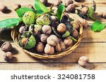Walnuts In Green Husks With...