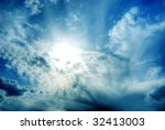 beautiful sky with clouds and sun creating a mystical light effect - stock photo