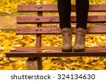 girl in boots standing on a red ...   Shutterstock . vector #324134630