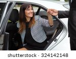 chauffeur helping young... | Shutterstock . vector #324142148
