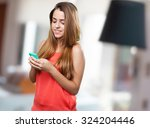 young cute woman using her... | Shutterstock . vector #324204446