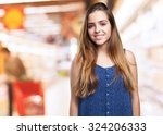 young woman smiling over white... | Shutterstock . vector #324206333