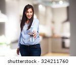 happy young woman with water... | Shutterstock . vector #324211760