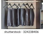 row of black pants hangs in... | Shutterstock . vector #324238406