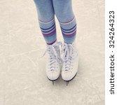 Girl Ice Skating. Child Winter...