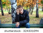 stressed kid sit on the bench...   Shutterstock . vector #324331094