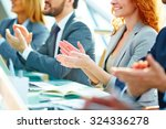 row of colleagues applauding to ... | Shutterstock . vector #324336278