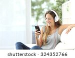 happy girl listening to music... | Shutterstock . vector #324352766