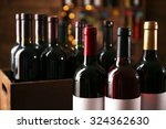 wine bottles in cellar | Shutterstock . vector #324362630