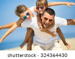 father with children having fun ... | Shutterstock . vector #324364430