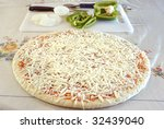 Raw Uncooked Pizza Pie With...
