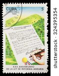 Small photo of CUBA - CIRCA 1989: A postage stamp printed in Cuba shows the anniversary of the signature of the law of agrarian reform, circa 1989