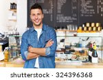 proud young cafe owner | Shutterstock . vector #324396368