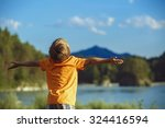 the boy raised his hands up... | Shutterstock . vector #324416594