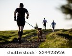 Man With A Dog On A Morning Run