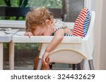 tired child sleeping in... | Shutterstock . vector #324432629