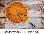 Homemade Pumpkin Pie On Wooden...