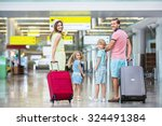 family with suitcases in the... | Shutterstock . vector #324491384