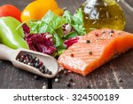 fresh salmon with vegetables on ... | Shutterstock . vector #324500189