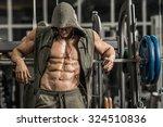 Guy Bodybuilder Tired In Gym...