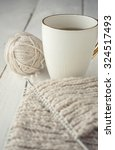 ball of gray yarn and knitting... | Shutterstock . vector #324517493