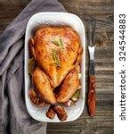 Roasted Chicken On Wooden Tabl...