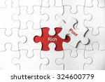 Small photo of Puzzle with a word Rich and Poor