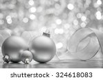 silver christmas balls on shiny ... | Shutterstock . vector #324618083