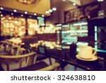 Stock photo blur or defocus image of coffee shop or cafeteria for use as background 324638810