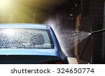 blue car washing on open air | Shutterstock . vector #324650774