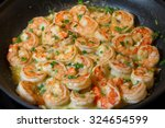 shrimp scampi sauteed in butter ... | Shutterstock . vector #324654599